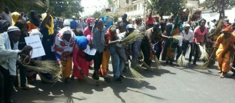 Protesters with brooms showing signs they want to sweep Jammeh out of The Gambia / UDP Photo, Suntou Touray