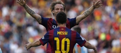 Leo Messi e Ivan Rakitic celebrando un gol frente al Granada CF