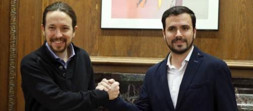 Pablo Iglesias y Alberto Garzón tras el acuerdo entre Podemos e Izquierda Unida