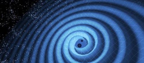 Proximidade entre buracos negros desencadeia ondas gravitacionais (LIGO)