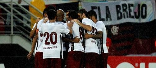 Jogadores do Flu comemoram um dos gols da vitória sobre o Flamengo no último domingo (Foto: Nelson Perez / Fluminense FC)