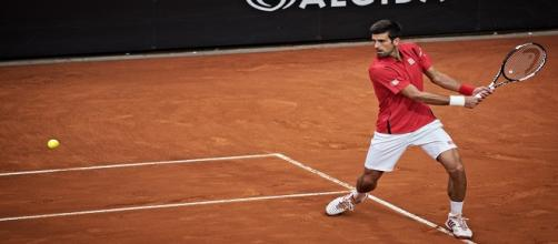 Djokovic hitting his well-known backhand last month in Rome/ Photo: Roberto Faccenda (Flickr) CC BY-SA 2.0