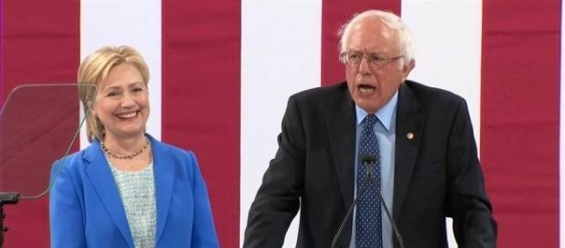 bernie sanders spews endorsement as hillary bobs her head to every