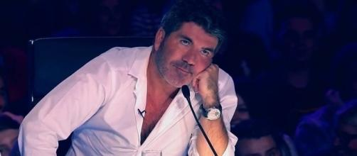 Simon Cowell was impressed by the young magician's audition (Image via Youtube)