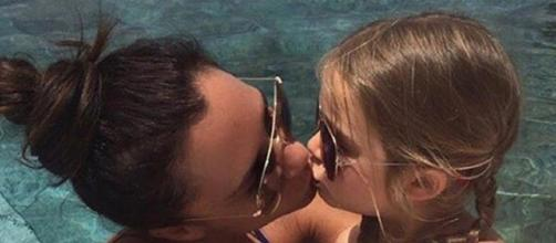 Victoria Beckham kisses daughter Harper on the lips