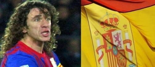 Puyol junto a la bandera de España