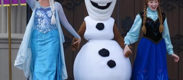 Olaf, Elsa, and Anna take the stage with Mickey at the Magic Kingdom.