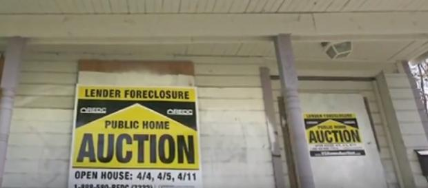 Screen capture of a home foreclosure. Crain's Chicago Business/YouTube.