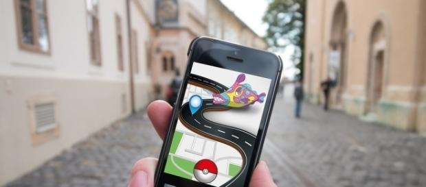 Playing the Pokemon Go app while hitting the streets.