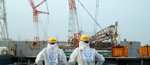Two IAEA workers at the Fukushima site in 2013 / Photo via Greg Webb, IAEA