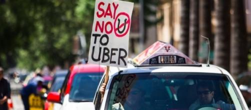Uber, Lyft lose Austin vote on background checks - Business Insider - businessinsider.com