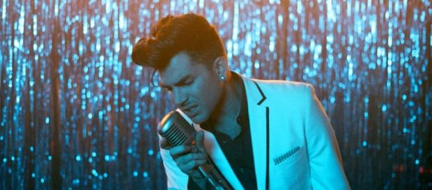 Adam Lambert singing. Photo Courtesy of Raphael Chatelain, Warner Bros. Records, used with permission.