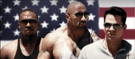 """Screen capture of 'Pain & Gain' poster. (L to R) Anthony Mackie, Dwayne """"The Rock"""" Johnson and Mark Wahlberg. MOVIECLIPS News/YouTube."""