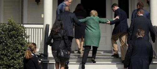 Hillary being helped up stairs seems to indicate something was wrong. Photo: YouTube screen shot by The Alex Jones Channel