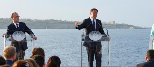 Renzi si esprime alla conferenza stampa di Berlino.