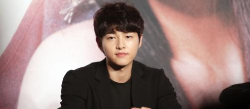 Song Joong-Ki at a press conference Image via Wikimedia commons