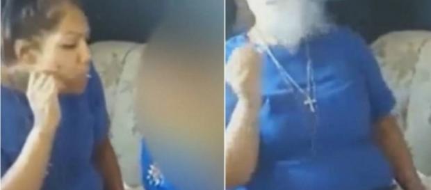 Mulher fuma cigarro na frente de criança