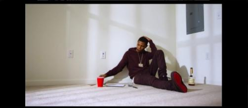 "A-Boogie looks on in his video for, ""Still Think About You"" Source: https://twitter.com/aboogiewhoodie/status/711926584077377536"