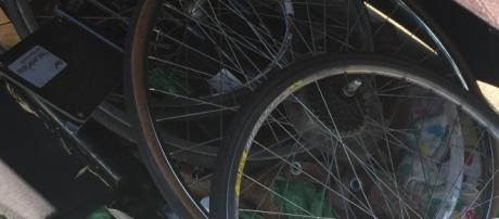 Stolen bike parts at one of the many homeless camps. Photo by Eric Lubell.