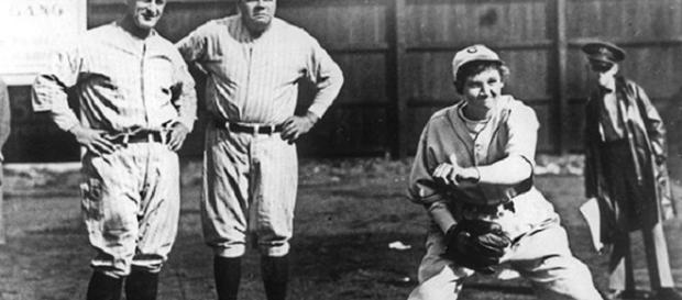 Jackie Mitchell throws fastball April 4, 1931 at in Chattanooga, Tennesse during spring training. Lou Gehrig and Babe Ruth look on (Getty Images)..