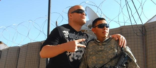 Tito Ortiz (left) poses with a soldier in this photo from 2009. Photo c/o Wikimedia Commons.