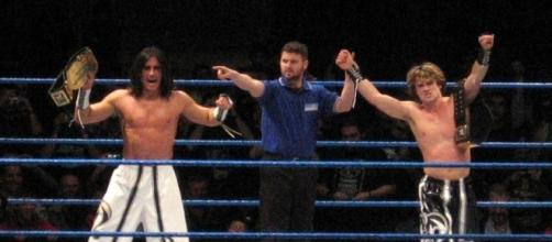 Brian Kendrick (right, with former tag partner Paul London in 2006) is back in the WWE after a seven-year absence. Photo c/o Wikimedia Commons.