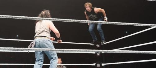 Dean Ambrose (right) prepares for a top-rope move against Luke Harper at a 2015 WWE house show. Photo c/o Wikimedia Commons.