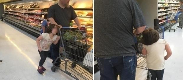 Na foto chocante, a criança aparece evidentemente desconfortável com a situação, enquanto o homem age como se nada estivesse acontecendo.