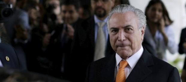 Presidente Michel Temer se surpreende com ministro de seu governo