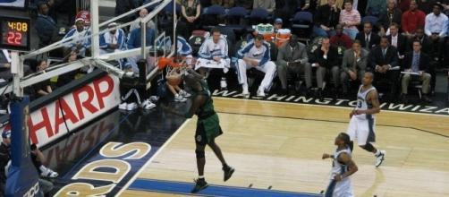 Kevin Garnett in 2008, playing for Boston and dunking the ball against the Washington Wizards. Photo c/o Terren Peterson/Wikimedia Commons.