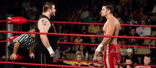 Kevin Owens (left) wrestling in Ring of Honor under his real name, Kevin Steen. Photo c/o Wikimedia Commons.
