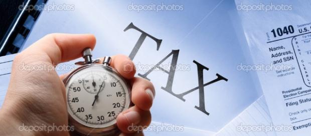 calendario, fiscali e cronometro in mano ... - depositphotos.com