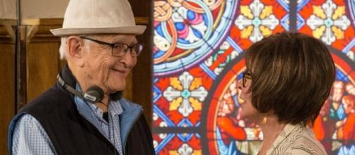 Norman Lear, left, and Rita Moreno visit on the set of 'One Day at a Time.' Photo via Michael Yarish, Media.Netflix.com Used by permission.
