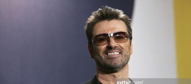 singer-george-michael-poses-at ... - gettyimages.com