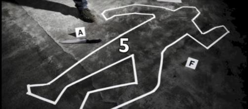 Investigation sur la cinquième scène de crime.
