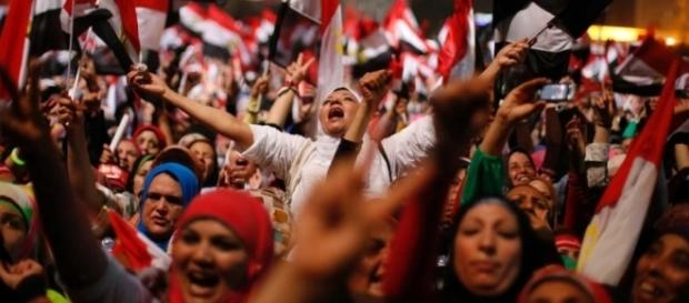 Egyptians react to the army's announcement in Tahrir Square - ABC ... - net.au