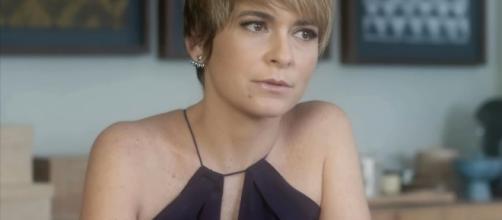 Cláudia Abreu é Heloísa em A Lei do Amor