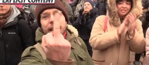 Shocking moment anti-Trump protester punches female reporter's ... - thesun.co.uk