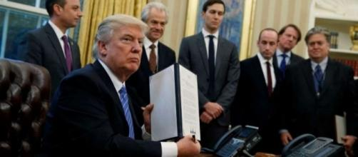 President Trump signing executive orders during first week of presidency. / Photo by Evan Vucci, Blasting News library
