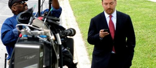 Chuck Todd on phone between broadcasts. Photo by Ray Boone (Flickr Commons)