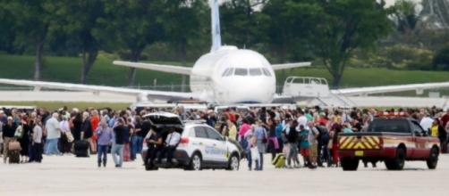 People evacuated from terminal after shooter opens fire at Ft. Lauderdale Airport - photo via abcnews.com