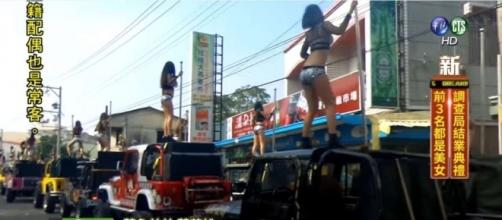 Pole dancers on jeeps grace late Taiwanese official's funeral procession / photo via chron.com