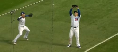 Anthony Rizzo squeezes the final out of Game 3 against the Nationals. [Image via Green Mode/YouTube]