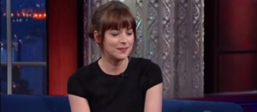 Dakota Johnson wants Jamie Dornan to get 'fully naked' in 'Fifty Shades Freed'. [Image via:The Late Show with Stephen Colbert/Youtube screenshot]