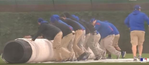 Tarp being rolled onto Wrigley - image - MLB / Youtube