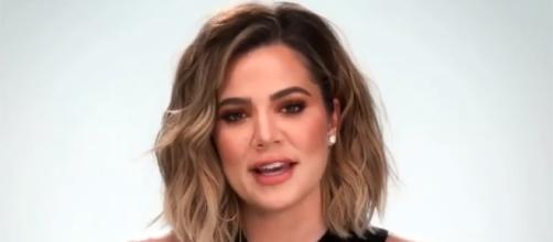 Khloe Kardashian stays silent about the pregnancy rumors surrounding her and her sisters. (Entertainment Tonight/YouTube)