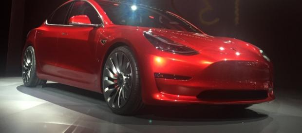 Red Tesla Model 3 at the March 31, 2016, unveiling event, Hawthorne, California by Steve Jurvetson/Wikimedia Commons