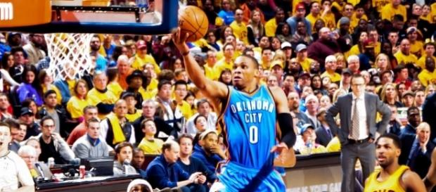 Russell Westbrook takes it to the hoop. [Image via: Erik Drost]