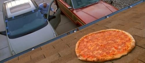 "Fans are of the pizza scene from ""Breaking Bad"" are recreating the scene making the new home owner mad. [Image credit: andrassy227/YouTube]"