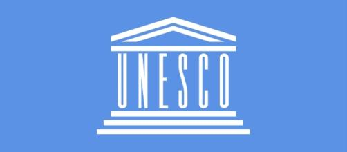 Flag of UNESCO [Image by By Mouagip (Based on the previous version of Madden)|Wikimedia Commons| Cropped | public domain ]